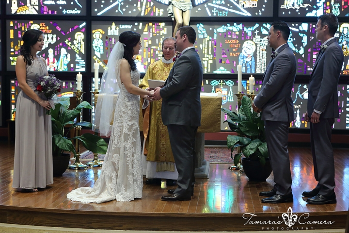 sacred heart of mary, weirton wedding photographer, pittsburgh wedding photographer, spring wedding, church, ring exchange, bride and groom, altar